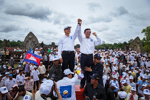CNRP opposition leaders Kem Sokha and Sam Rainsy in front of Angkor Wat in Siem Reap. Jul. 24, 2013 ©Erika Pineros
